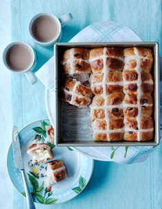 Hot Cross Buns | Lightly sweet hot cross buns are a delicious teatime treat any time of year. If you don't own a pastry bag, you can put the icing in a small sealable plastic bag and snip off the corner.