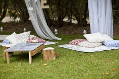HANG MOSQUITO NETS from TREES + ADD- Blankets, Big Patterned Pillows to Sit On, Lanterns with Flame-LESS Votives for Ambiance. (OPTIONAL: LOW TABLES for a Themed Party Table Decor and with Lanterns, Food, Flowers, etc.)