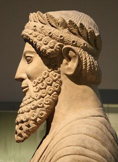 From the Sanctuary of Apollo at Idalion (near modern Dali, Nicosia district), this massive head is from a larger than life statue of a worshipper or priest, with long beard and a luxurious wreath on his head giving the suggestion of royalty. Limestone, c.480-450 BC. British Museum, London