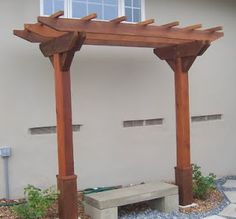 Wooden arbor with stone bench