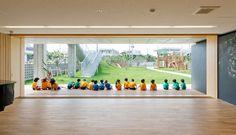 Hanazono Kindergarten designed by HIBINOSEKKEI + youji no shiro in Japan | blackboard walls and large floor space for group activity