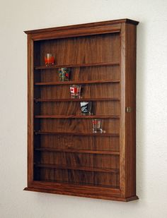 Hey, I found this really awesome Etsy listing at http://www.etsy.com/listing/102452085/72-walnut-shot-glass-display-case