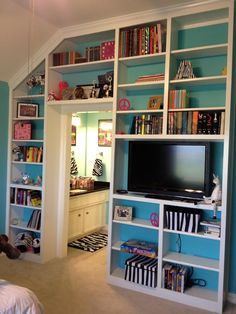 I love this!it's like a huge organizer + holds the T.V.If I had this in my room,it would never get dirty.