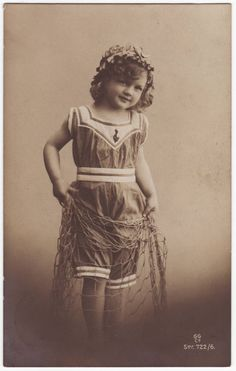 Antique european postcard with the portrait of a little girl in a bathing suit, holding a fishing net - 1910