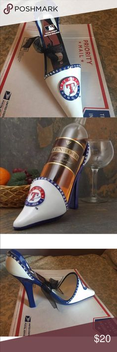 Texas Rangers Wine Bottle Holder Glass High Hill Ladies, you enjoy the finer things in life. You love designer shoes, diamonds and of course, your Rangers. Now you can combine everything you adore when you display your bottled beverages in this decorative Texas Rangers High Heel Shoe bottle holder. This rhinestone encrusted team-colored high heel holder features a 3D team logo on the front and the team name on the sole for a touch of class that will make all of your Texas girlfriends envious…