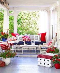 """Comfort zone      An """"entryway"""" of potted plants leads to furniture arranged for conversation, creating the sense of a special retreat on a large porch. Outdoor-safe fabrics mean there is no reason to skimp on cushions and pillows."""