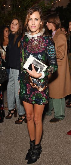 Arriving to celebrate the Burberry show, Alexa Chung wearing a hand-embroidered sequin shift dress at Makers House in London