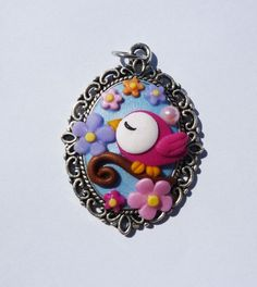 Cameo pendant decorated with flowers and pink bird in polymer clay handmade - Ciondolo cameo decorato con fiori e uccellino in fimo fatti a mano