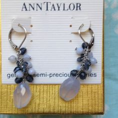"Ann Taylor Earrings w genuine semi-precious stones These silver tone Ann Taylor earrings have beautiful pale lavender and amethyst colored genuine and semi-precious stones. They have a lever back and have a total drop of 1 3/4 "". They will be just the thing for either casual or dressy wear. Never worn! Ann Taylor Jewelry Earrings"