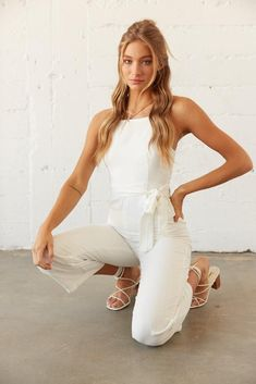 Hey babe! Meet our Carmel Belted Linen Jumpsuit. This fresh summer piece features a high straight across neckline, an adjustable tie at the waist, and a flattering silhouette. Available in white. Complete this dreamy look with the Genovesa Block Heel and you'll set for your next spring occasion! Sorority Rush, White Jumpsuit, Babe, Neckline, Meet, Rompers, Silhouette, Fresh, Spring