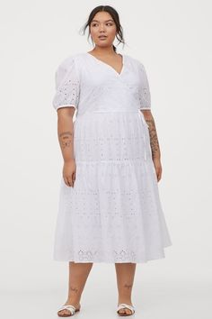 Calf-length dress in an airy cotton weave with broderie anglaise. V-neck with a sewn-in wrapover at the top and short puff sleeves with narrow, covered elas Fat Fashion, World Of Fashion, Cotton Dresses Online, Dress Online, Calf Length Dress, Fashion Company, Summer Wardrobe, Flare Skirt, Lady