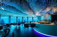 SUBSIX Where: Maldives The world's first underwater nightclub...off the coast of the Maldives and sits six meters, hence the name, beneath the Indian Ocean. Floor-to-ceiling windows make it possible for visitors to view manta rays and fish swimming by, while they sip ...cocktails... guests take a boat to get to the bar. And if you're looking for a break from the underwater scene, you can head to Edge, an open-air restaurant that sits above Subsix on the water.