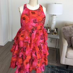 100% silk empire Floral Zara Dress size Medium 100% silk Zara dress with tiers. Such a beautiful color and print. Size Medium and new with tags. Zara Dresses