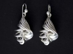 Caracola earrings in silver http://www.geekprints.es/Collection/Knot/Caracola-Earrings-Silver