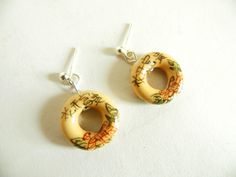 Ceramic donut earrings, made with silver plated findings and ceramic charms.  Facebook group: https://www.facebook.com/groups/369513179327/?ref=bookmarks  Email: NoodleJewellery@hotmail.com