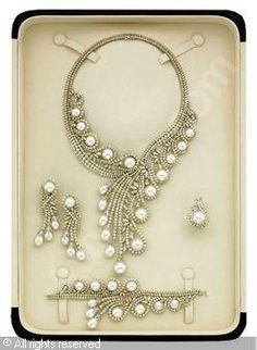 Set of 5: cultured pearls and diamond, diamonds stated to weigh a total of 123.79 carats. Pearls stated to weigh 115.20 carats Elie Chatila
