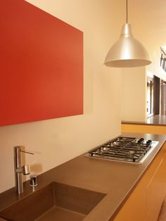 Resort Residence Kitchen Is Energizing Among Orange Also Siilver Accent Applied Near Wall And Furniture Modern Residence with Bright Colors in Minimalist Interior