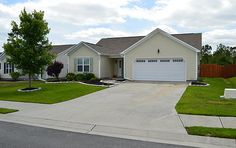 209 Belvedere Drive Holly Ridge, NC 28445 by JG Homes, INC  |  The perfect house to call home!  First thing you will notice is the custom landscaping that greets you at the curb.