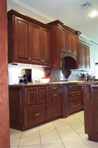 how to decorate kitchen cabinets the cherry wood cabinets with slightly lighter wood 7226