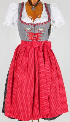 Ribbon matches apron nicely. Pretty dirndl with check bodice and red spotted apron.