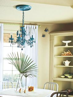 Crystal Color Give a crystal chandelier new life as a colorful light fixture. Spray-paint the entire fixture one color as an eye-catching focal point.