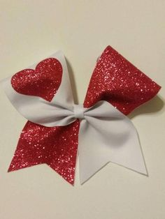 Large cheer bow made with ribbon with Valentine theme. Glitter pink heart on white with a full glitter side Tic Toc Bow This bow is attached to a French barrette for a secure hold. Dance Team Hair, Valentine Theme, Valentines, Glitter Hearts, Cheer Bows, How To Make Bows, Grosgrain Ribbon, Hair Bow, Pink