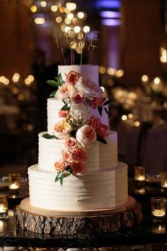 Four Tier Cake Covered with Fresh Flowers | Brides.com
