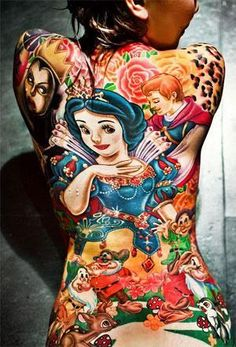 Annfaye Kao spent three months having the entire line-up of Snow White characters tattooed all over her body.