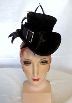 this look is really elegant for center pieces. Table numbers and sponsor  logos on the hat band and feather 7284f8dd638