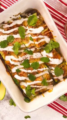 Swap out the tortillas for sliced zucchini and you have a lighter version of the classic shredded chicken enchilada.