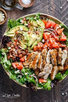 BLT Balsamic Chicken Avocado Feta Salad is a delicious twist to a BLT in a bowl, with a balsamic dressing that doubles as a marinade! You won't even miss the bread in this mega loaded salad. | http://cafedelites.com Feta Salad, Cobb Salad, Balsamic Dressing, Balsamic Chicken, Paella, Salad Recipes, Avocado, Honey Balsamic Dressing, Balsamic Vinegar Dressing