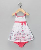 You've got a curious cutie who appreciates outfits that give her room to move. This easy-on ensemble lets her explore her world and budding fashion sense. Buttons up the back and a sleeveless silhouette will have her ready to be cooed over in a second. An extra layer of lining and coordinating diaper cover ensure she's always picture-perfect no matter how mischievous your mini miss gets. Inc...