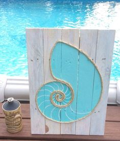 handmade nautilus shell with rope beach pallet art - Brico Depot Peinture Bois2131