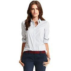 Tommy Hilfiger women's shirt. An undeniable wardrobe staple: Our striped dress shirt in cotton poplin with just enough stretch to ensure a feminine fit (they're best-sellers for a reason).<br/>• Classic fit.<br/>• 97% cotton, 3% elastane.<br/>• Spread collar, princess seams. <br/>• Machine washable.<br/>• Imported.<br/><br/>