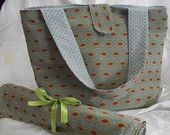 Diaper Bag and changing pad. Interior pockets. Blue/Green and a bit of red with blue interior. Ready to ship $55.00