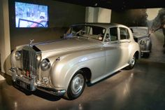 A 1962 Rolls-Royce Silver Cloud II with the licence plate CUB 1, owned by Bond film producer Albert R. 'Cubby' Broccoli. A replica of this car was used in A View To A Kill (1985).