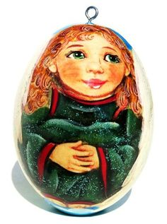 Angel Michael Russian hand painted Christmas wooden ornament is on sale now. Adorable angel with golden locks dressed in green and red is featured in the front.