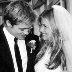 Brad and Jennifer 14 years ago.  One of the cutest wedding pictures ever, even if it didn't last