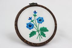embroidery hoop picture  hoop art  hand embroidered wall hanging flowers blue flower anemones leaves haftowany obraz anemony
