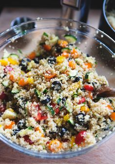 Summer Vegetable Quinoa Salad 1 cup quinoa, uncooked 2 zucchini, quartered 2 bell peppers (red, yellow, orange), chopped small 1 cup cherry tomatoes – red/orange, halved 2 green onions, thinly sliced 1/2 cup  (3.8 oz.) black olives, sliced 4 Tbsp olive oil 1 tsp garlic powder salt + pepper Optional – add baked tofu or chicken for protein