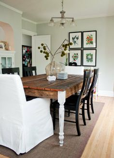Like the mismatched dining room furniture--white upholstered chairs with wood chairs and farmhouse table