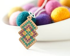 Cross Stitch Jewelry Kit - DIY Bamboo Pendant with Interlocking Diamond Pattern. $14.00, via Etsy.
