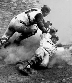 Carl Yastrzemski slides across the plate with Boston's final run in the eighth inning in the Red Sox' 8-3 first game victory over Cleveland in Aug. 1963.  Catcher Joe Azcue reaches to make the tag, but too late to do any good.  (AP Photo/Julian C. Wilson)  SI VAULT: Yaz leads Red Sox to top of American League (8.21.63) #EasyPin