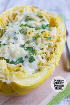 A healthier way to serve a favorite dip, this Spinach Artichoke Spaghetti Squash Recipe has squash combined with spinach, artichokes, and a creamy cheese sauce.