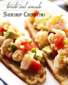Tomato and Avocado Shrimp Crostini - Beautifully poached shrimp are marinated in lemon and olive oil and paired with grilled bread, diced tomato, and avocado in this Shrimp Crostini. Poaching keeps the shrimp tender and infuses them with flavor. So good! | justalittlebitofbacon.com