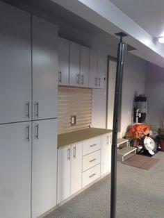 Gerry garage slotwall epoxy floor custom cabinets for Ak kitchen cabinets calgary