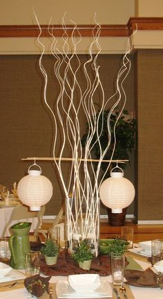 White curly willow sticks and rocks for Asian centerpiece with Japanese lanterns