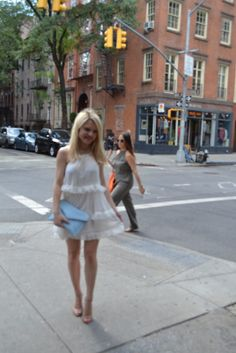 white-dress--blue-clutch http://styledamerican.com/tiered-ruffles/