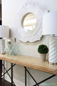 Love this fresh entryway styling and gorgeous console table! So affordable too!