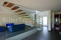 Tempered glass Open staircase Floating stairs by Siller Treppen design Christian Siller